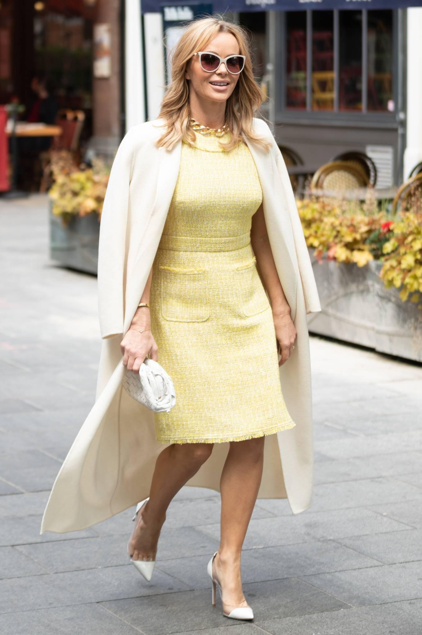 Amanda Holden - In yellow dress and a cream long coat at Heart radio London