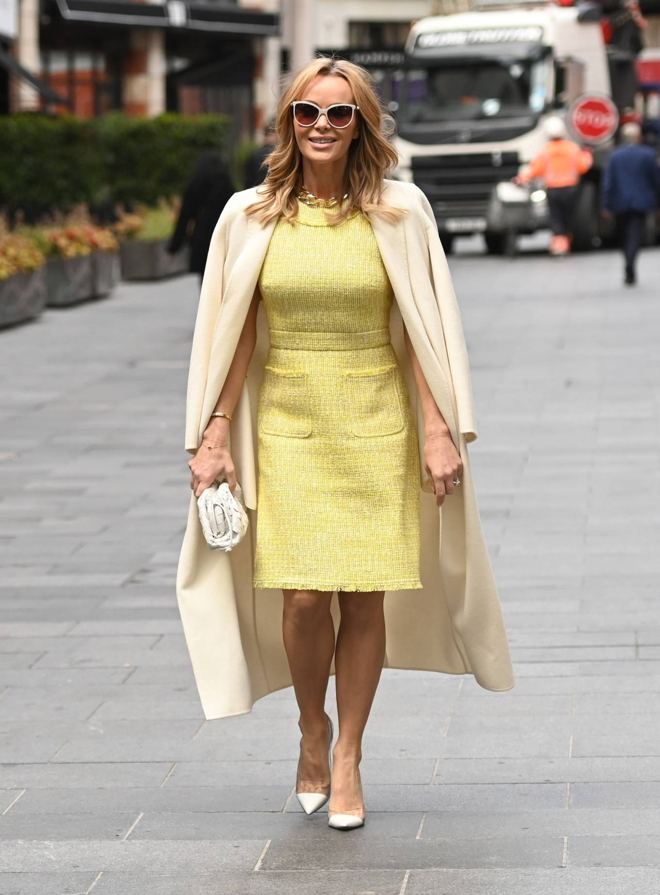 Amanda Holden 2021 : Amanda Holden – In yellow dress and a cream long coat at Heart radio London-11