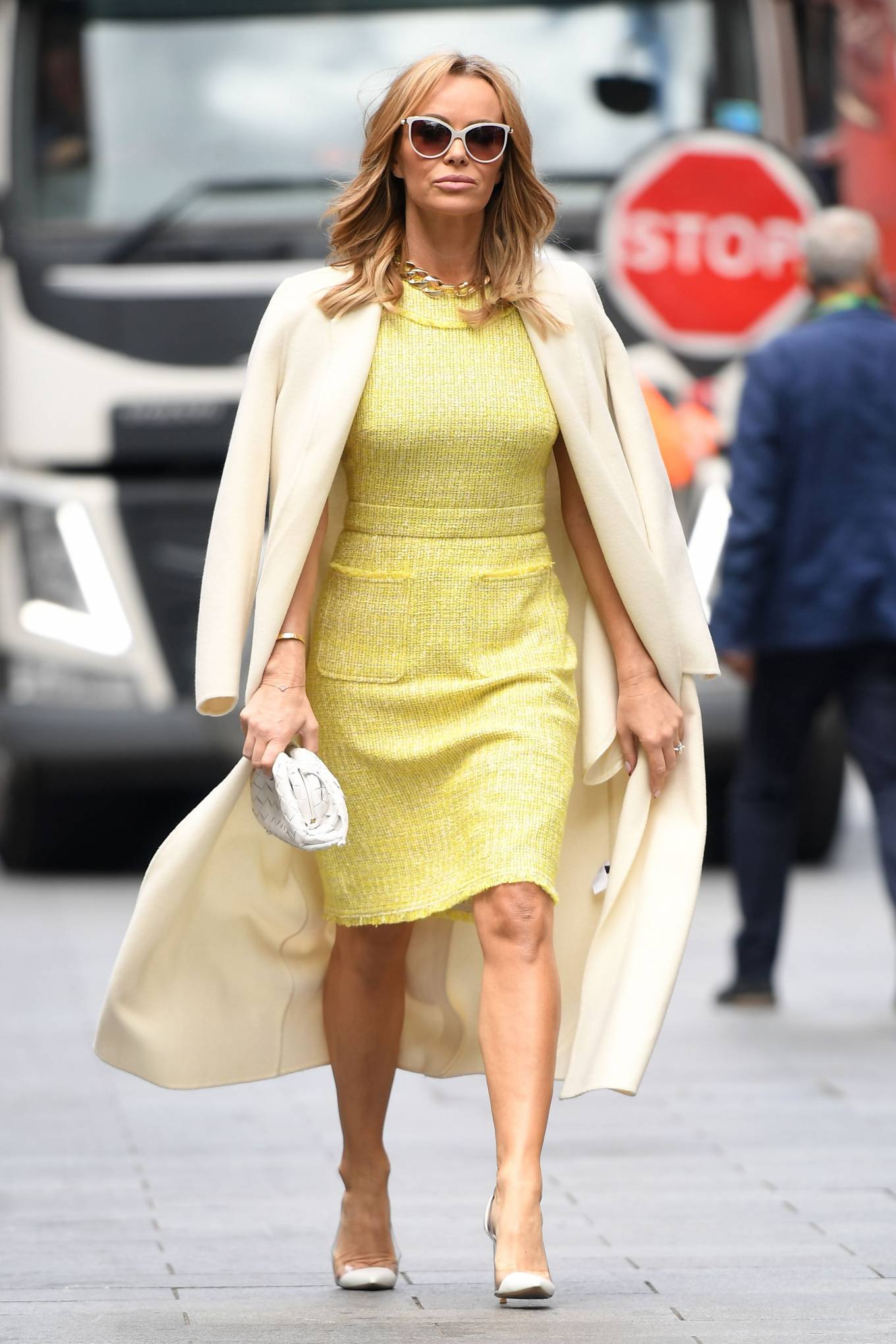 Amanda Holden 2021 : Amanda Holden – In yellow dress and a cream long coat at Heart radio London-12