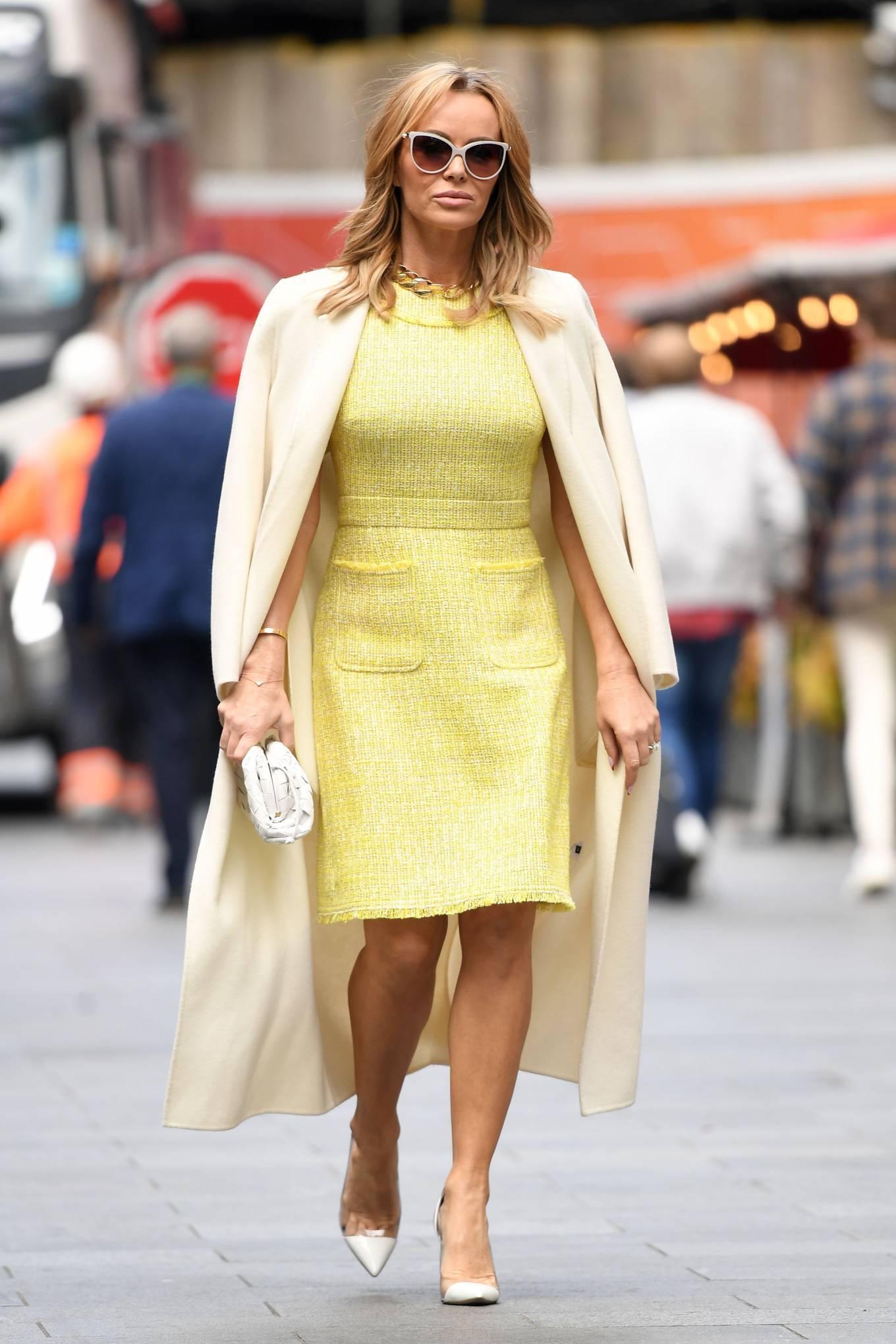 Amanda Holden 2021 : Amanda Holden – In yellow dress and a cream long coat at Heart radio London-13