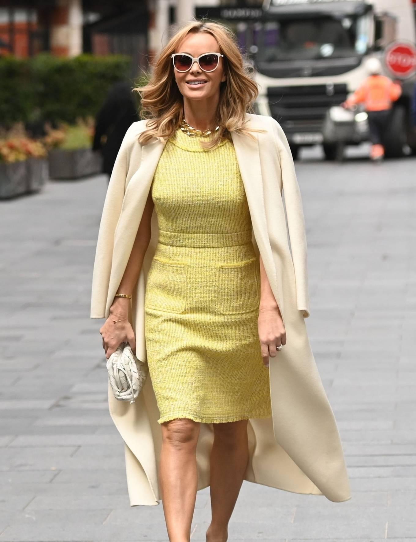 Amanda Holden 2021 : Amanda Holden – In yellow dress and a cream long coat at Heart radio London-14