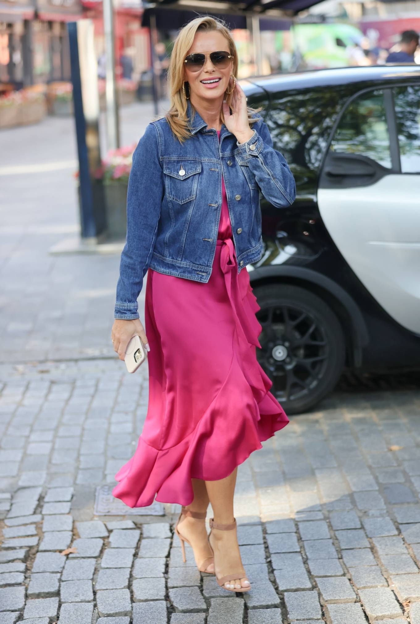 Amanda Holden - Out in a glowing pink dress and denim jacket at Heart radio in London