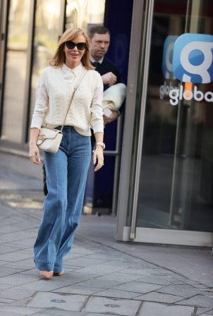 Amanda Holden - Out in flared denim and cream top in London