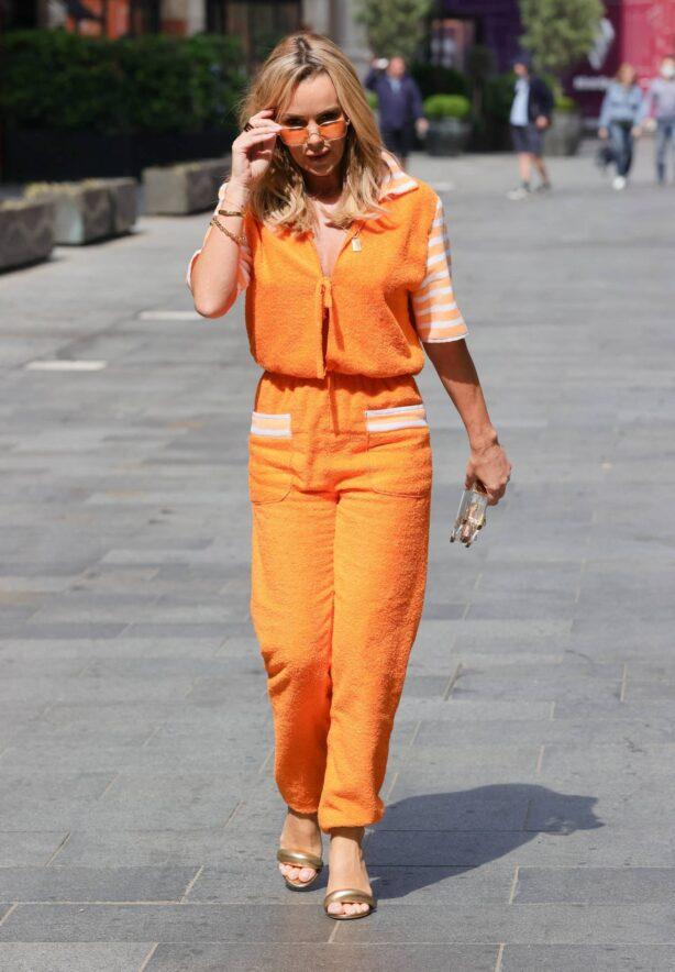 Amanda Holden - Seen in a bright orange jumpsuit at Heart radio in London