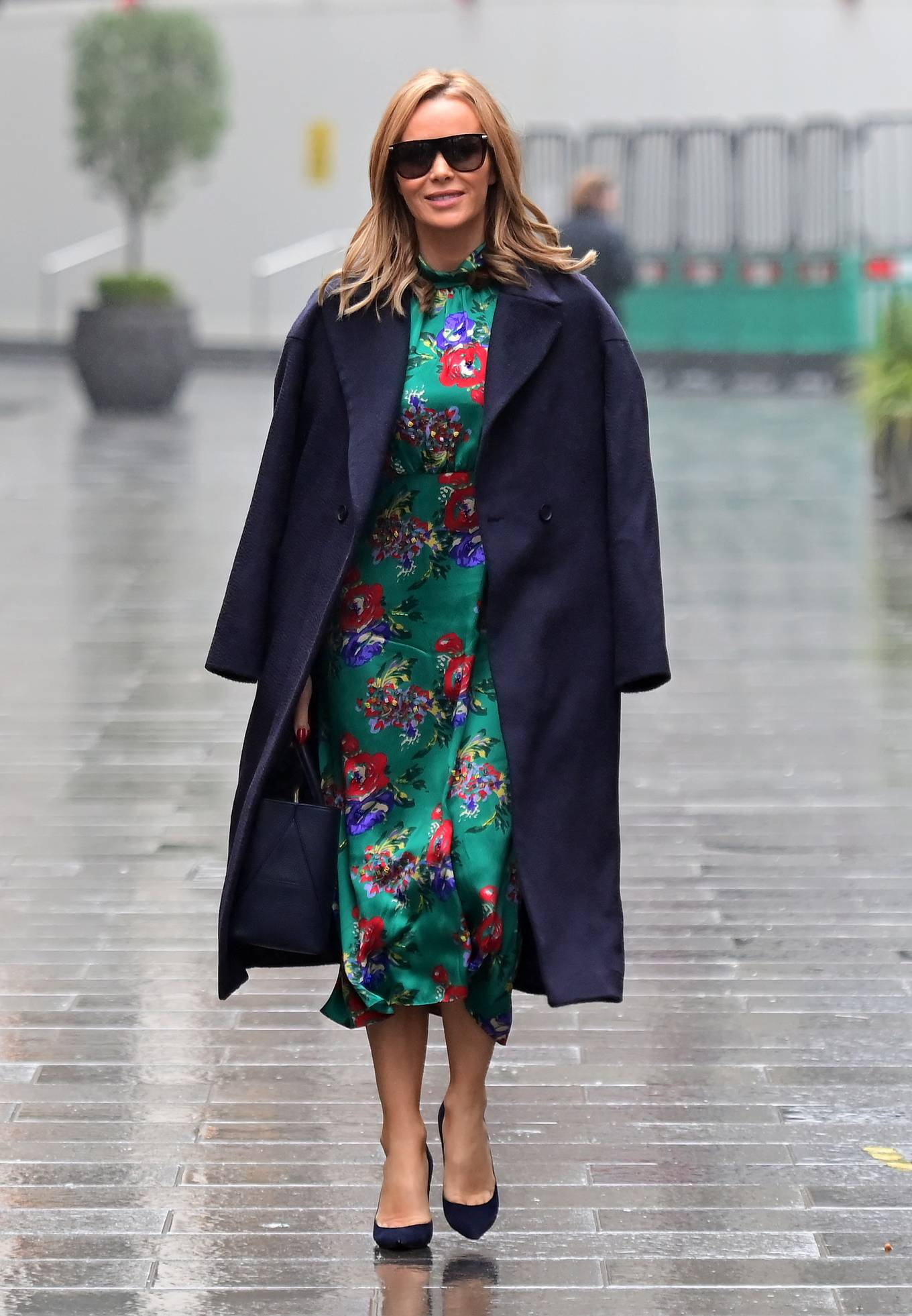 Amanda Holden - wearing a floral dress while leaving Heart Radio in London