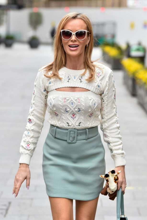 Amanda Holden - Wearing River Island top and Other stories skirt in London