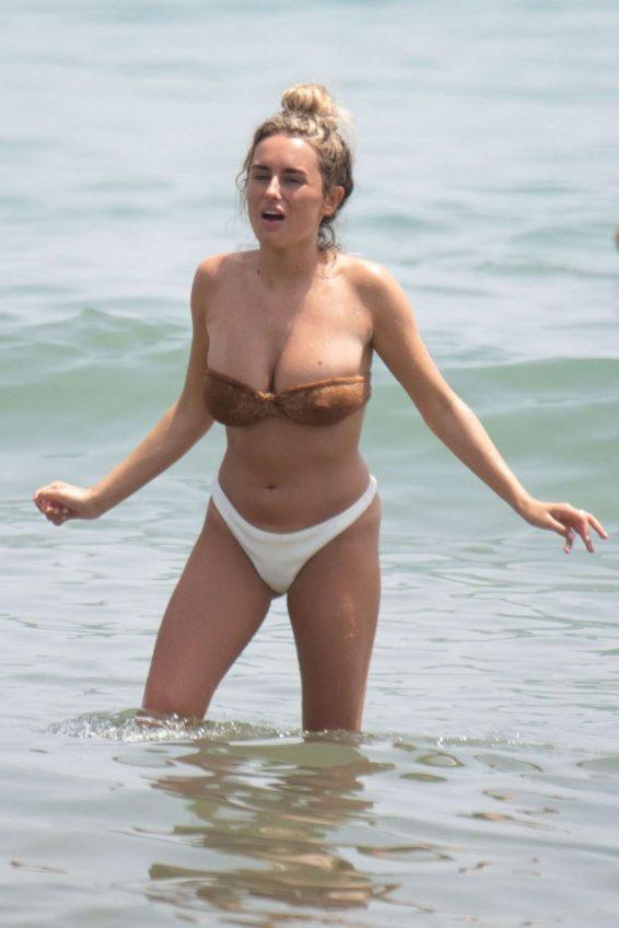 Amber Davies in Bikini on the beach in Marbella