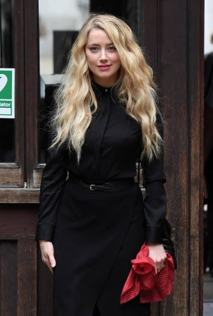 Amber Heard - All in black at the Royal Courts of Justice in London