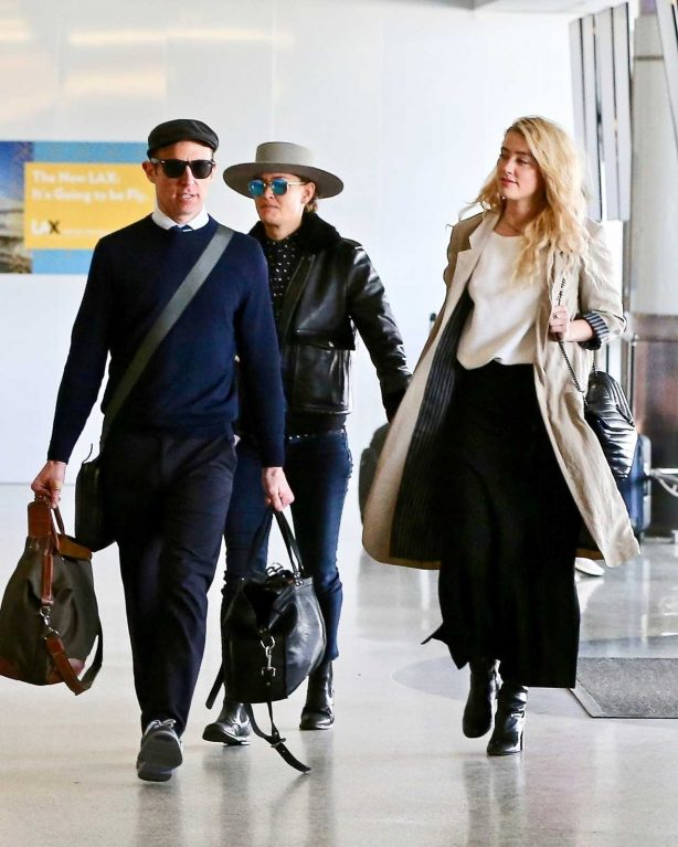 Amber Heard and Bianca Butti depart from LAX
