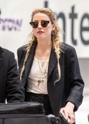 Amber Heard - Arrives at Heathrow Airport in London