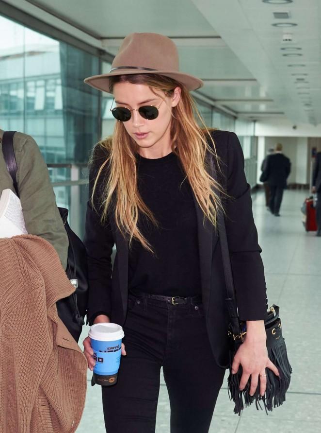 Amber Heard - Arrives at Heathrow Airport in London