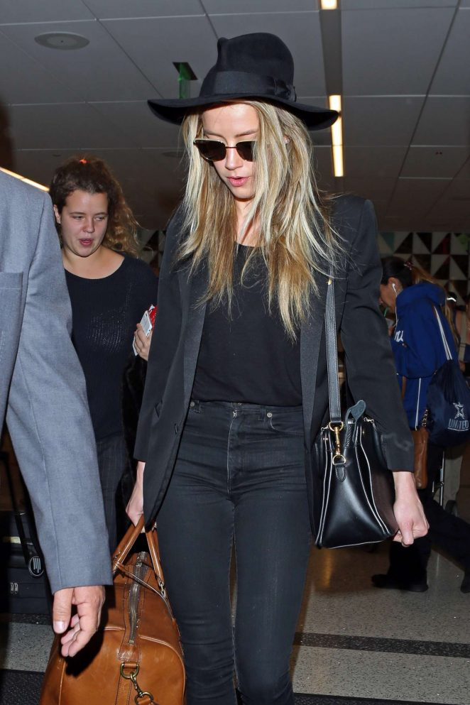 Amber Heard Arrives at LAX in Los Angeles