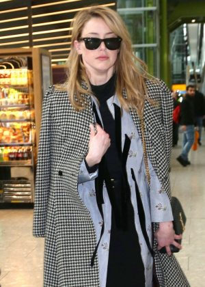 Amber Heard - Arriving at Heathrow Airport in London