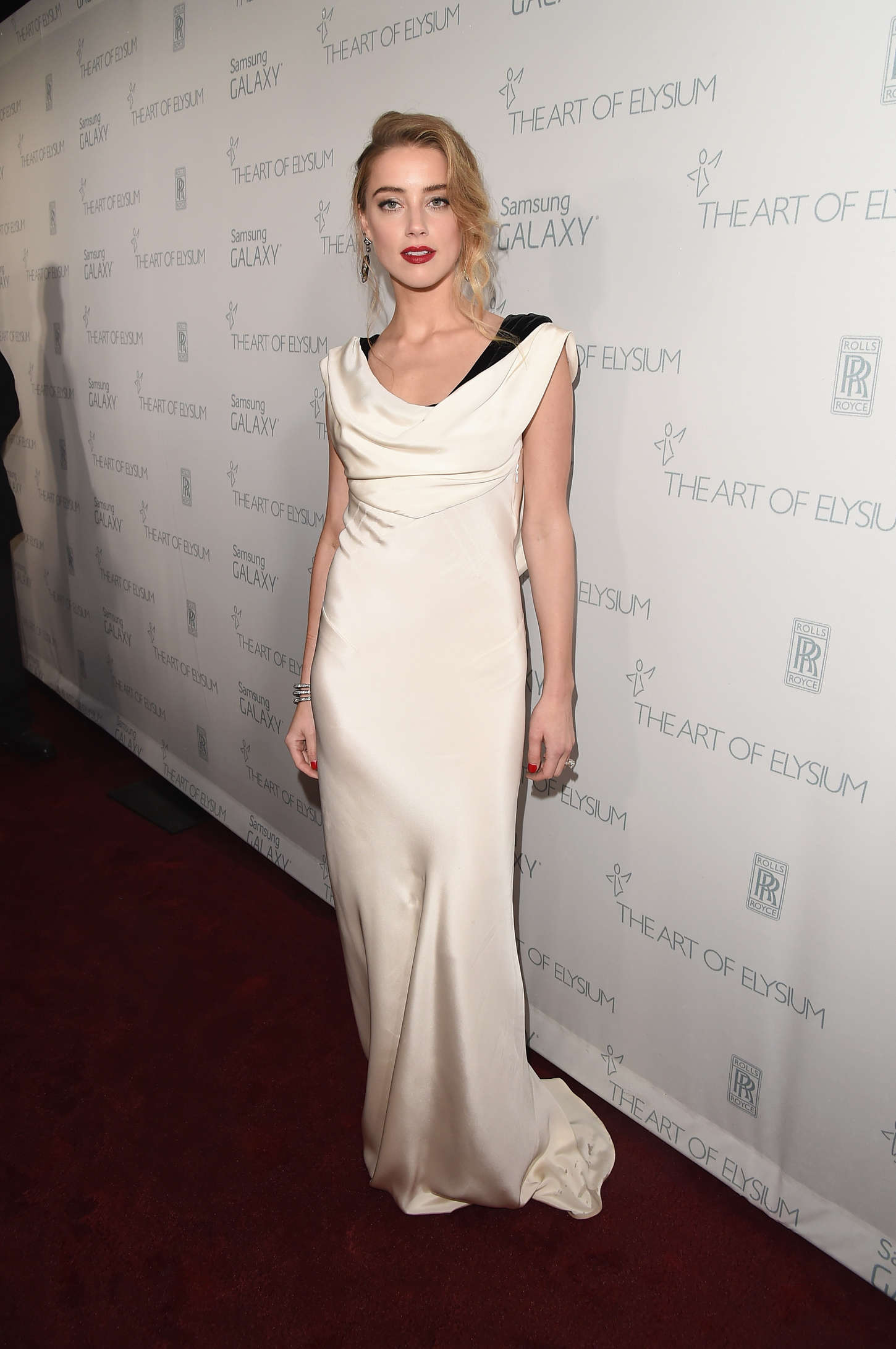 http://www.gotceleb.com/wp-content/uploads/photos/amber-heard/art-of-elysium-8th-annual-heaven-gala-in-los-angeles/Amber-Heard:-Art-Of-Elysium-Heaven-Gala-2015--18.jpg