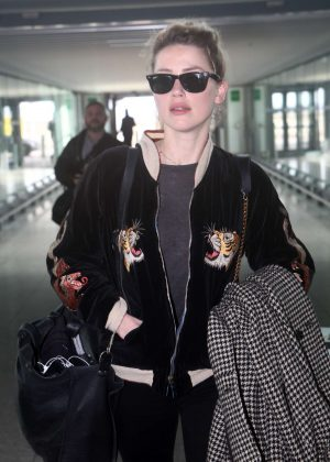 Amber Heard at Heathrow Airport in London