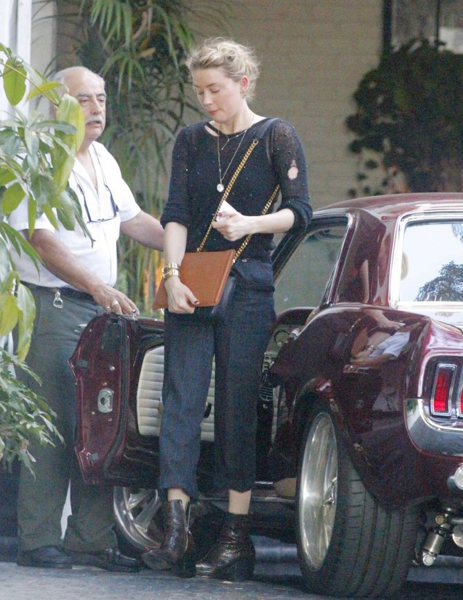 Amber Heard – Attends a conference in Beverly Hills