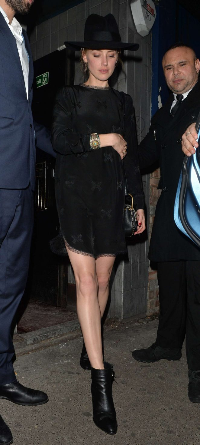 Amber Heard in Black Mini Dress out in London