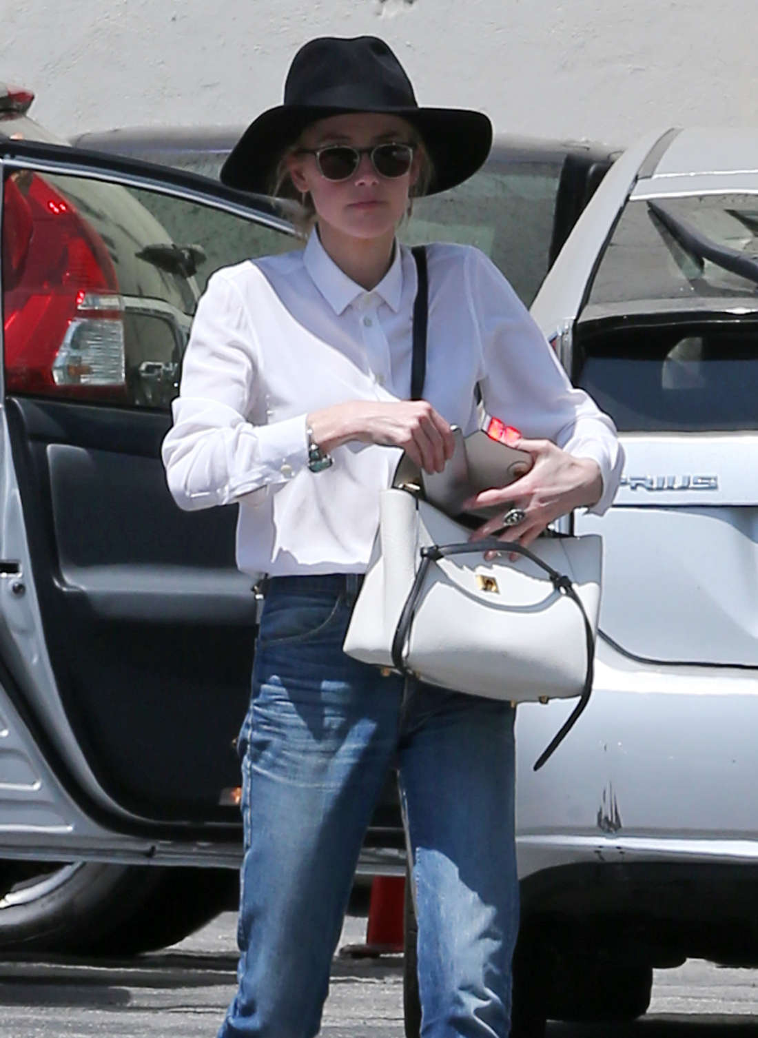 Amber Heard in Jeans and Hat out in Los Angeles