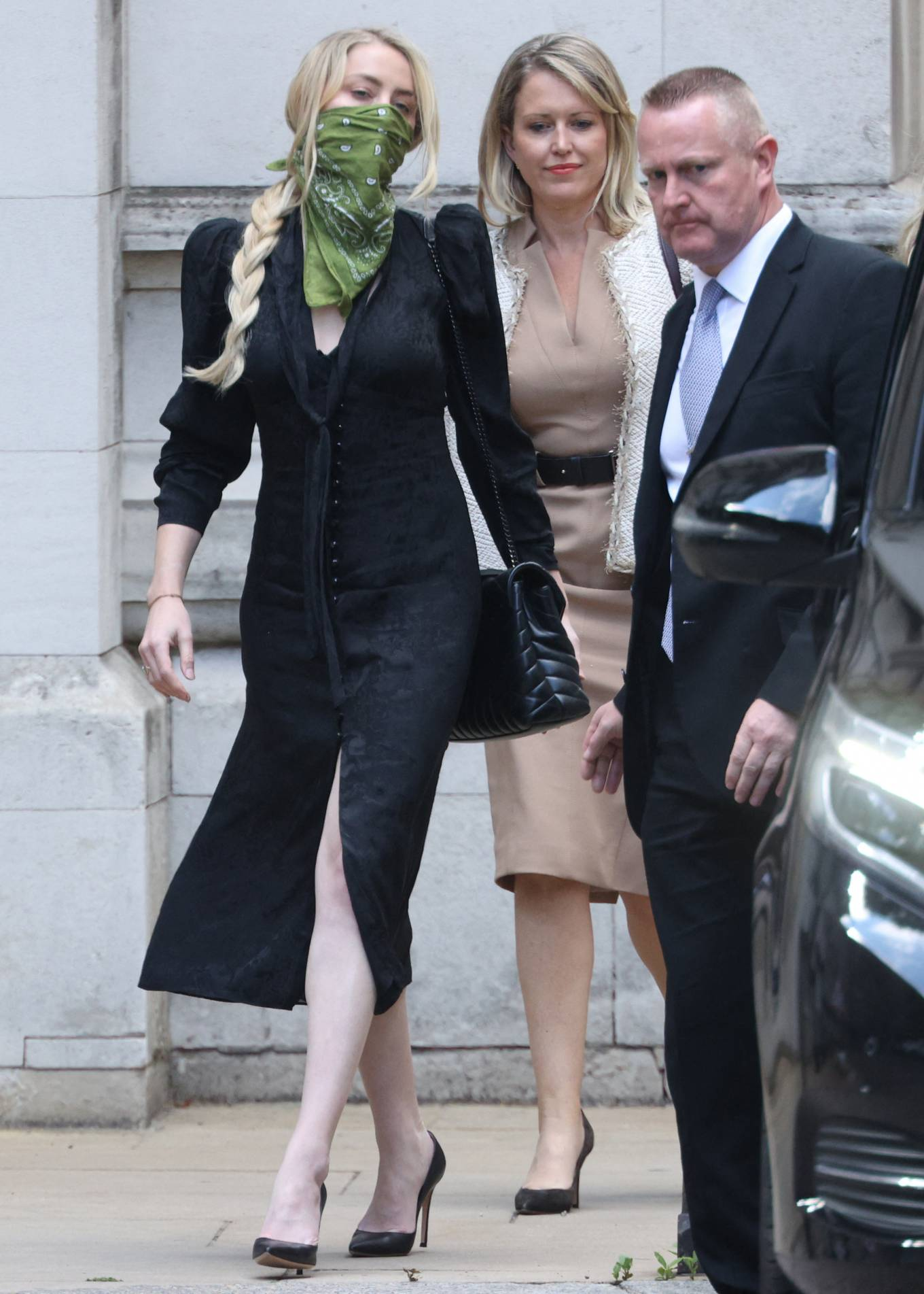Amber Heard - Pictured leaving the High Court in London