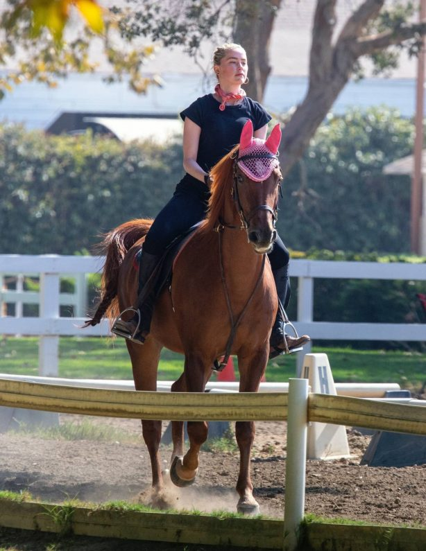 Amber Heard - Pictured while horseback riding in Los Angeles