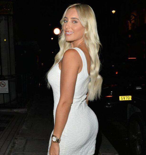 Amber Turner - In a white mini dress seen leaving Bagatelle in London