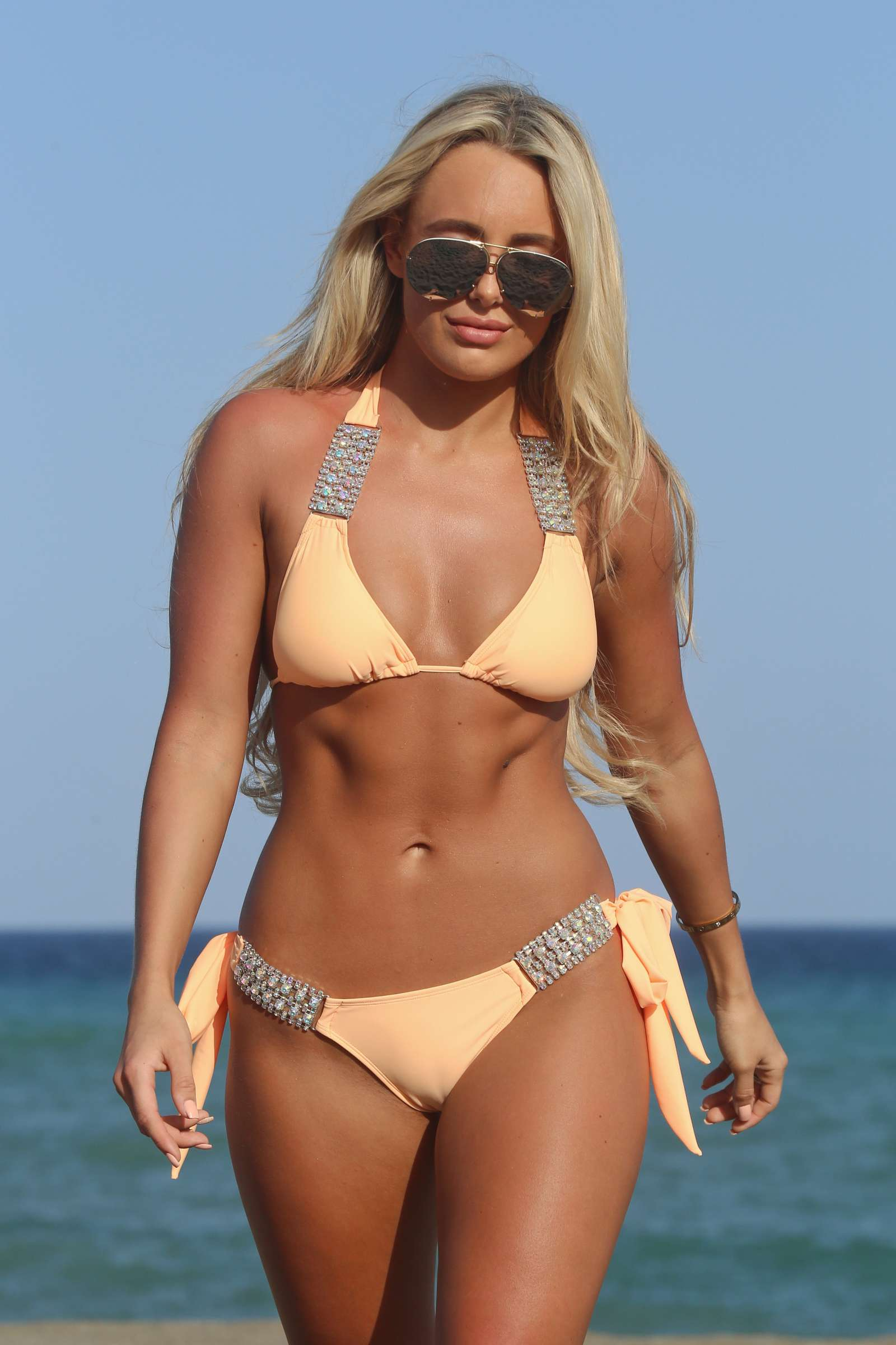 amber turner in bikini on a beach in marbella