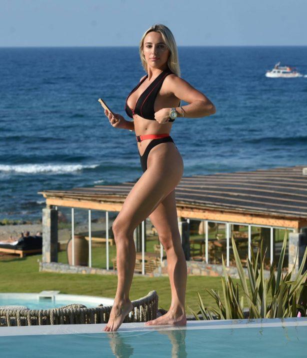 Amber Turner - In bikini poolside in Crete