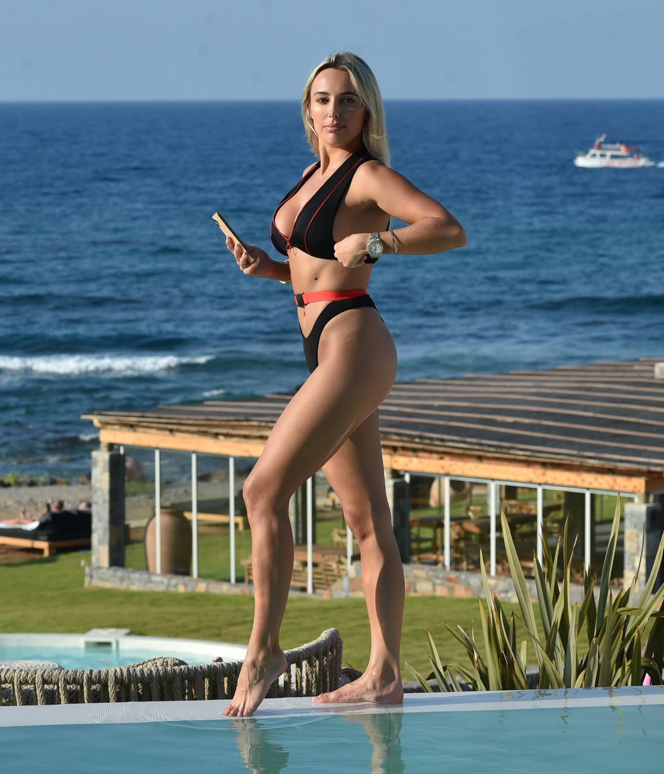 Amber Turner - In bikini poolside in Crete