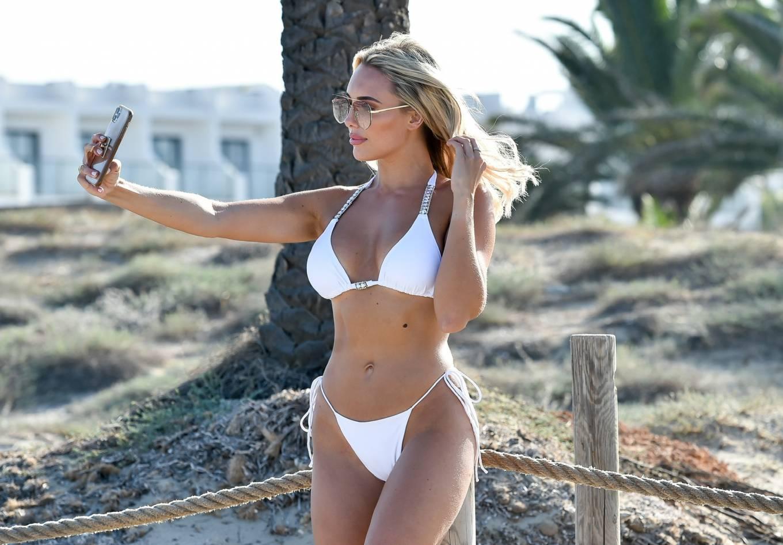 Amber Turner - In white bikini on the beach in Ibiza