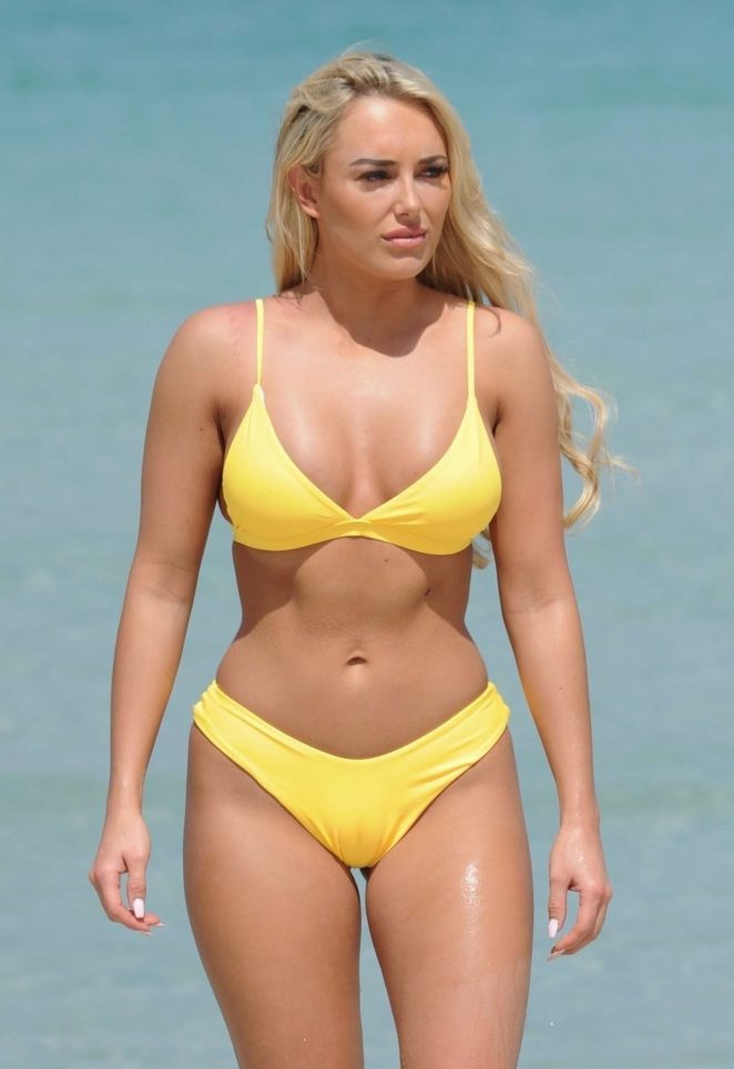 Amber Turner in Yellow Bikini on the beach in Dubai
