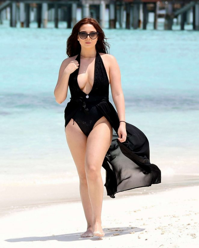 Amelia Goodman in Black Swimsuit on the beach in Bahamas