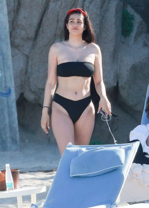 Amelia Hamlin in Black Bikini on the pool in Cabo San Lucas