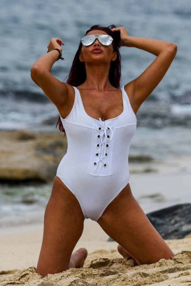 Amy Childs in a White Swimsuit on the beach in Cape Verde