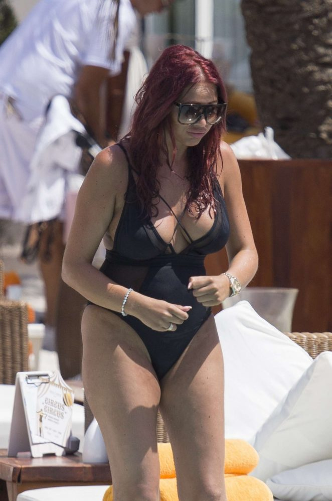 Amy Childs in Black Swimsuit at a pool in in Ibiza
