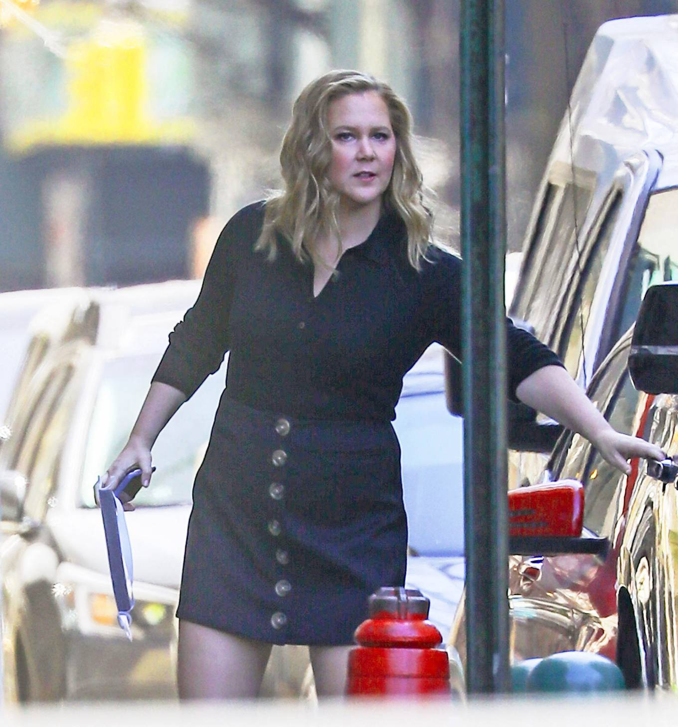 Amy Schumer - In short black button-down dress on her way to an NY Pops Up event in Manhattan