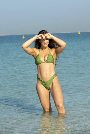 Amy Willerton - In a green bikini on the beach in Dubai
