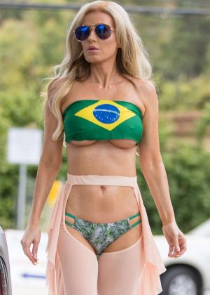 Ana Braga - Wears Brazil top at gas station in Los Angeles