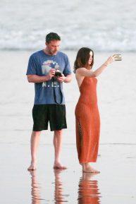 Ana De Armas - Stroll in red dress on the beach in Costa Rica