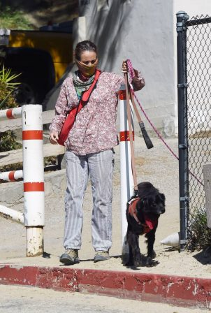 Andie MacDowell - Walking her dog at a park in Los Angeles