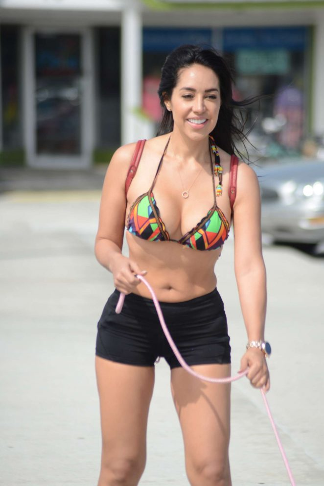 Andrea Calle in Bikini Top and Shorts - Rollerblading with her bulldog in Miami