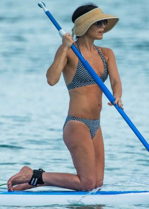 Andrea Corr in Bikini Paddleboarding in Barbados