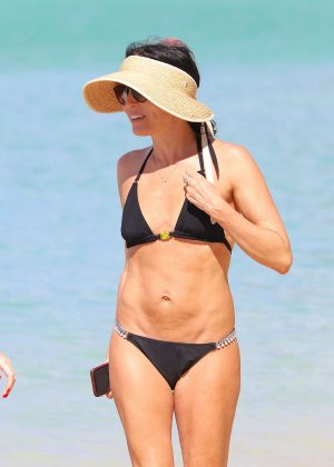 Andrea Corr in Black Bikini at the beach in Bridgetown