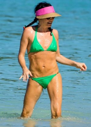 Andrea Corr in Green Bikini on the beach in Barbados