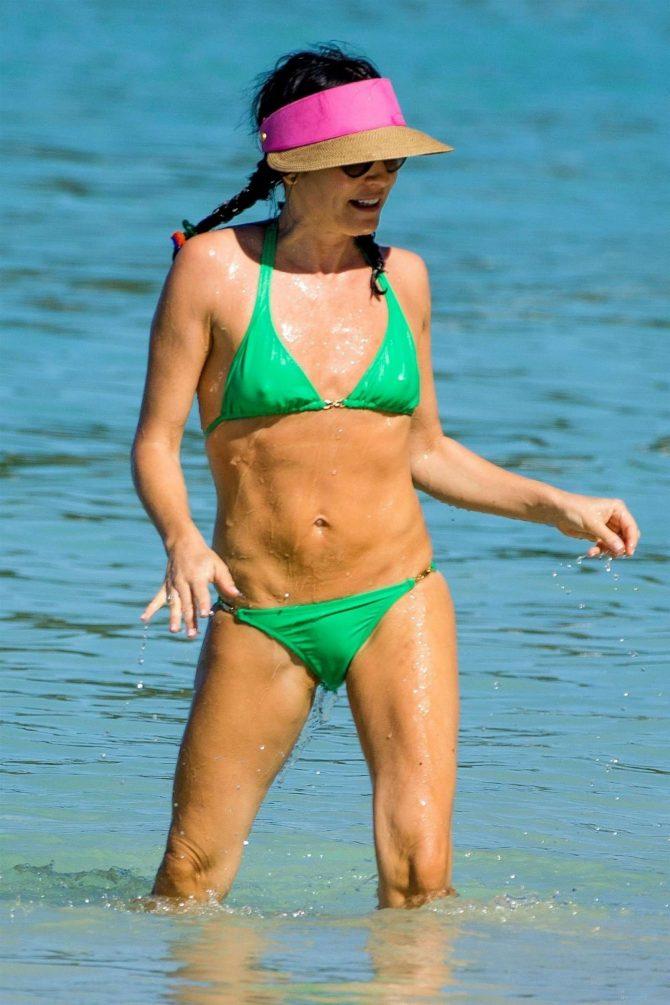 Andrea Corr in Green Bikini on the beach in Barbados