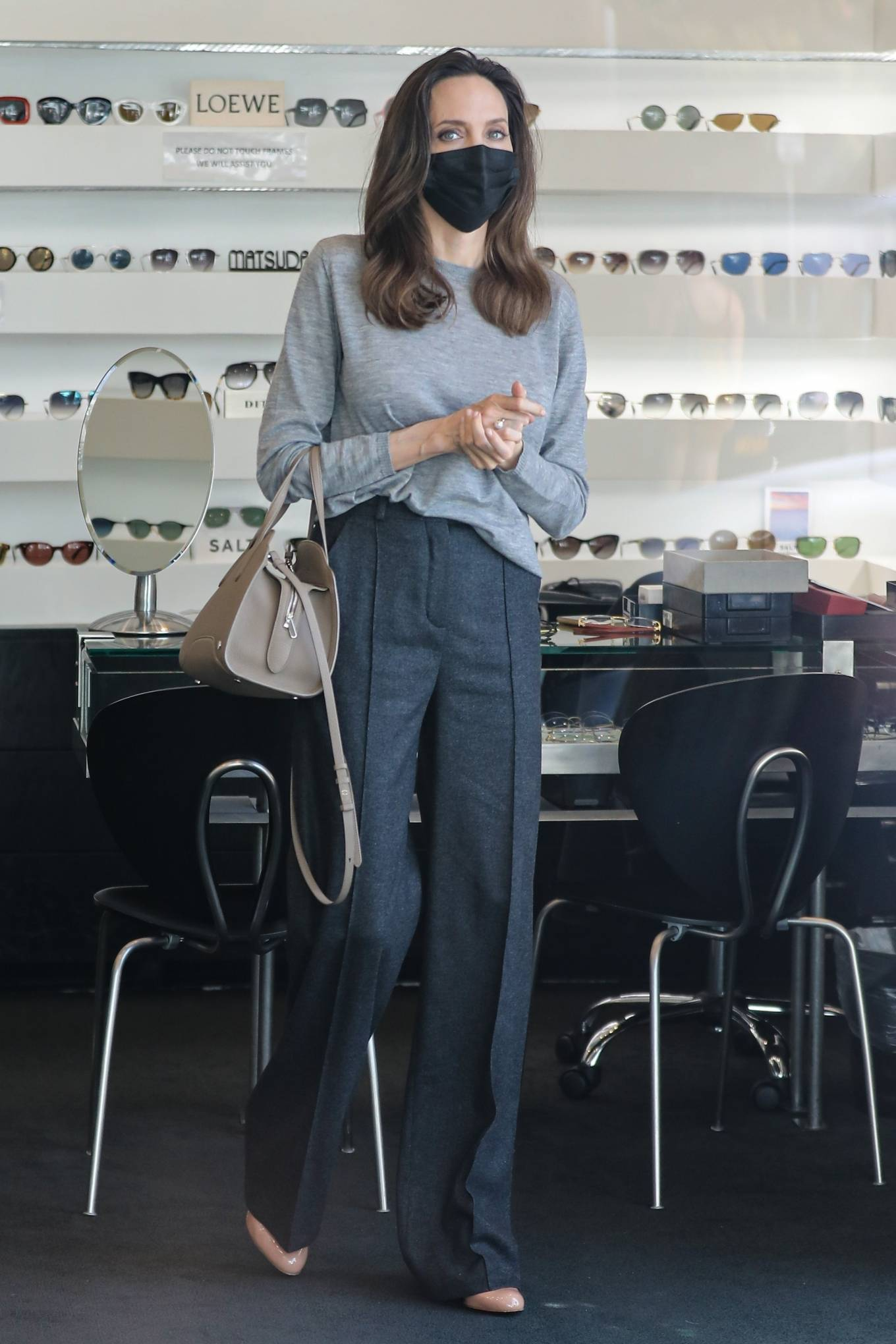 Angelina Jolie - Shops for sunglasses at Optometrix Professional Eye Care Center in Beverly Hills