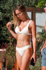 Ann-Kathrin Brommel in White Bikini on the pool in Ibiza