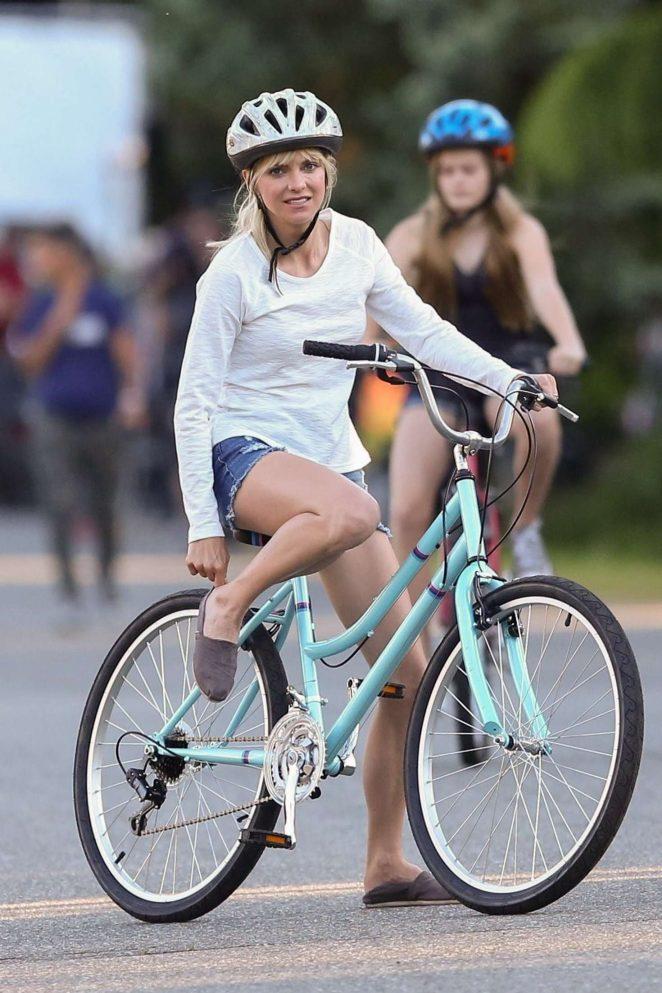 Anna Faris rides a bike for a scene in Overboard -04