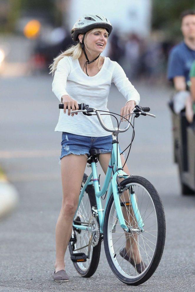 Anna Faris rides a bike for a scene in Overboard -06