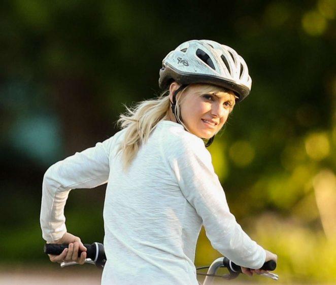 Anna Faris rides a bike for a scene in Overboard -17