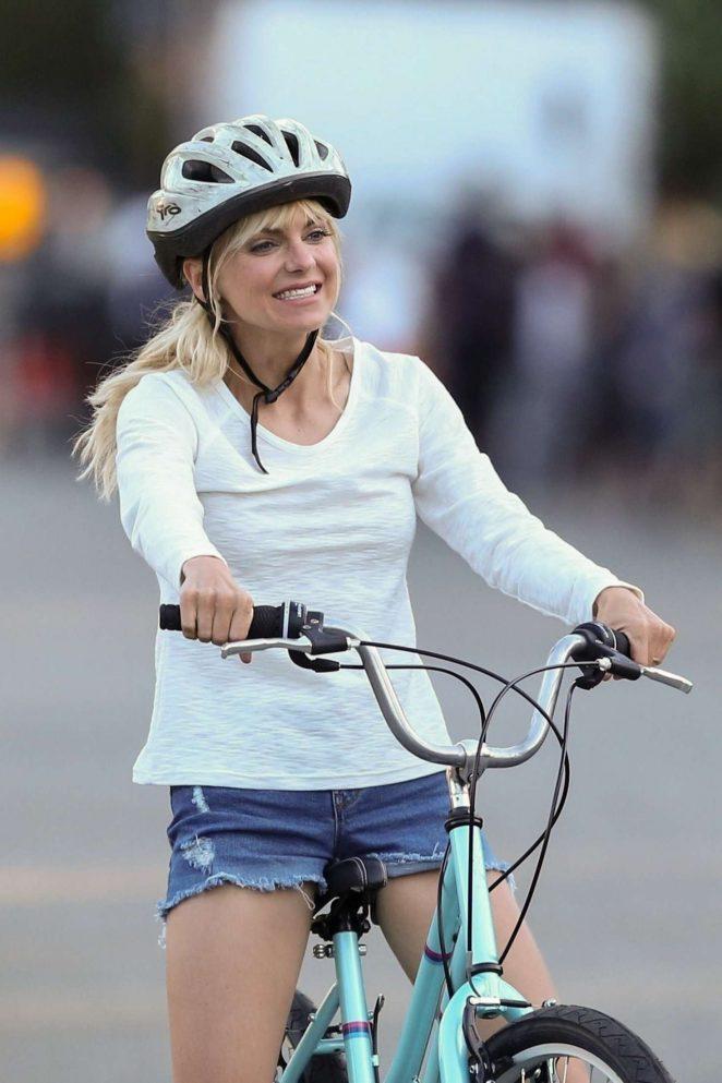 Anna Faris rides a bike for a scene in Overboard -26